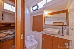 The stern cabin in this version of the Dufour 390 sailboat comes with head en suite with seperate shower. Wide windows lighten up the room with natural light and parts of the interior is build in oak wood.