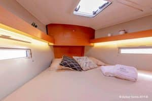 The master cabin of the Dufour 390 sailing yacht is very spacious for a 39 feet boat.