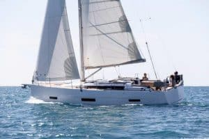 The Dufour 390 glides through the glittering sea under full sail. A nice side view of this small but fine yacht.