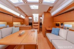 The salon of the new Dufour 390 has many hull and deck windows, so it is very bright. This sailing yacht has a good storage concept. The dining table is foldable and gives freedom of movement.