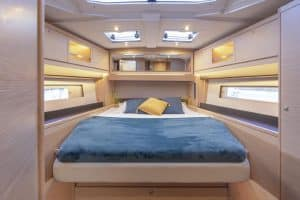 The owner's cabin of the new Dufour 470 sailing yacht located in the bow. It is not only spacious, but also light and airy thanks to the many hull and deck windows. The cabin offers lots of necessary storage space and a wide double bed.