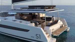 View of the large cockpit of the Fountaine Pajot New 51 sailing catamaran and the hydraulic bathing platform for the dinghy or jet ski at the stern