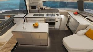 The elegant kitchen with island in the catamaran Fountaine Pajot New 51 offers plenty of storage and work space as well as refrigeration equipment.