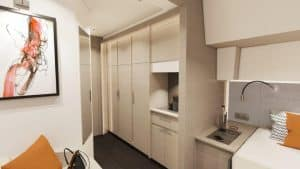 The spacious dressing area in the owner's cabin of the Fountaine Pajot New 51 sailing catamaran offers plenty of storage space.