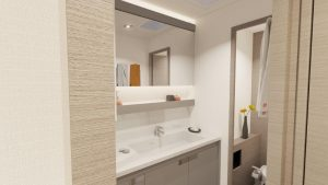 The bathroom in the owner's cabin of Fountaine Pajot New 51 sailing satamaran is modern and has a wide vanity, a separate toilet and a large shower