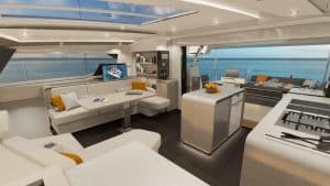 The airy salon of the catamaran Fountaine Pajot New 51 includes 2 sofa areas, a galley with island and the chart table conveniently at the entrance