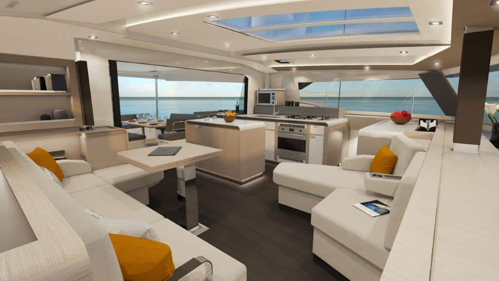The salon of the catamaran Fountaine Pajot New 51 is flooded with day light through the roof windows and can be opened completely to the cockpit.