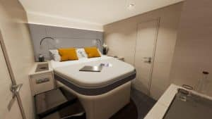 Example of look and equipment of one of the guest cabins in the Fountaine Pajot New 51 catamaran with comfortable double bed accessible from the side.