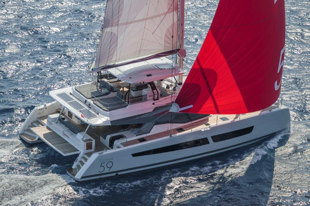 Side view of the elegant space wonder Fountaine Pajot Samana 59 catamaran with full genaker sailed in the Mediterranean Sea.