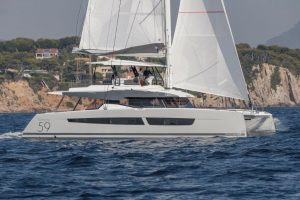 The sailing catamaran Fountaine Pajot Samana 59 sails off the coast of Mallorca. The fantastic navigation performance leaves nothing to be desired.