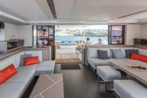 The dining table in the salon of the Fountaine Pajot Samana 59 sailing catamaran is variable. The large stern sliding door can be opened completely.
