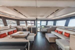 The modern salon in the luxurious Fountaine Pajot Samana 59 sailing catamaran is large, bright and has doors to the bow and stern area of ​​the yacht.