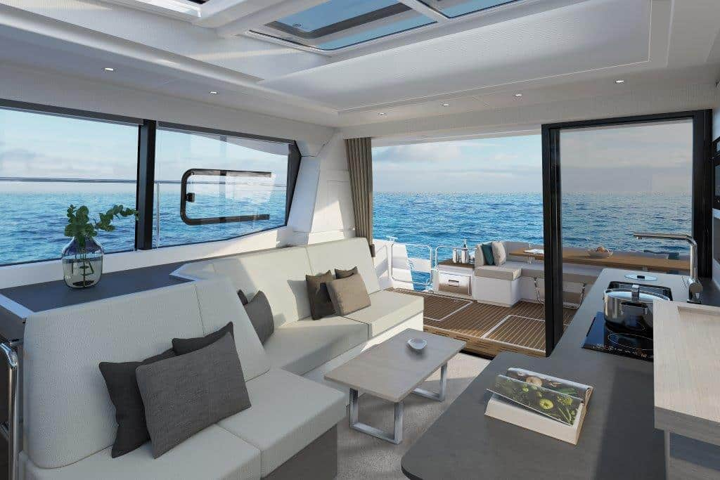 The salon of the Fountaine Pajot MY4.S motor catamaran is flooded with day light thanks to the many windows and has a large sofa area.